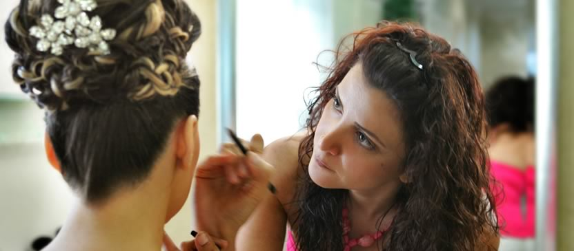 Bride-to-be having her make-up applied by a professional make-up artist.